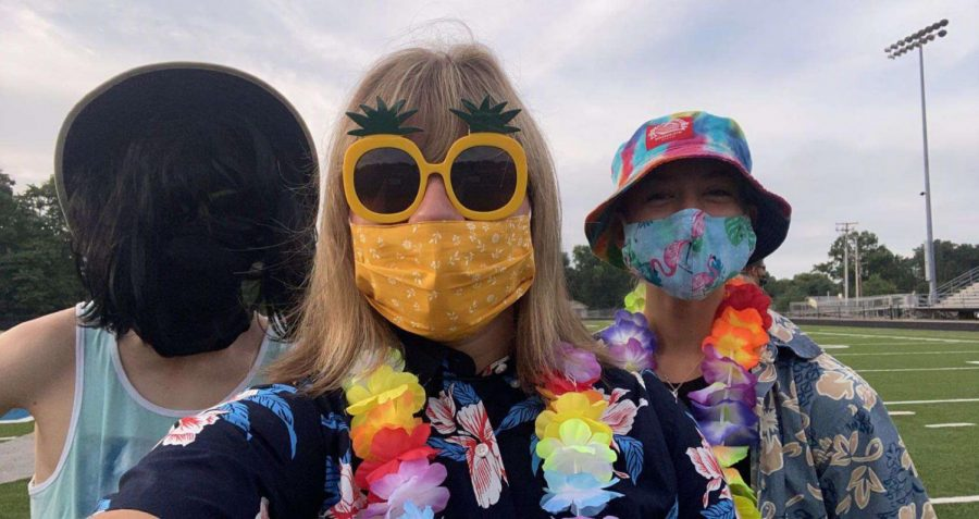 Summer band camp essentials: sunglasses, leis, and masks.